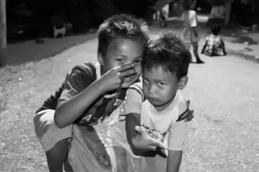 People Photography Streetphotography People And Places Street Portrait Street Photography Black And White People Outdoors Orang Asli Children Night Photography Friendship Playing Outside Childhood Togetherness Looking At Camera Happy Moments
