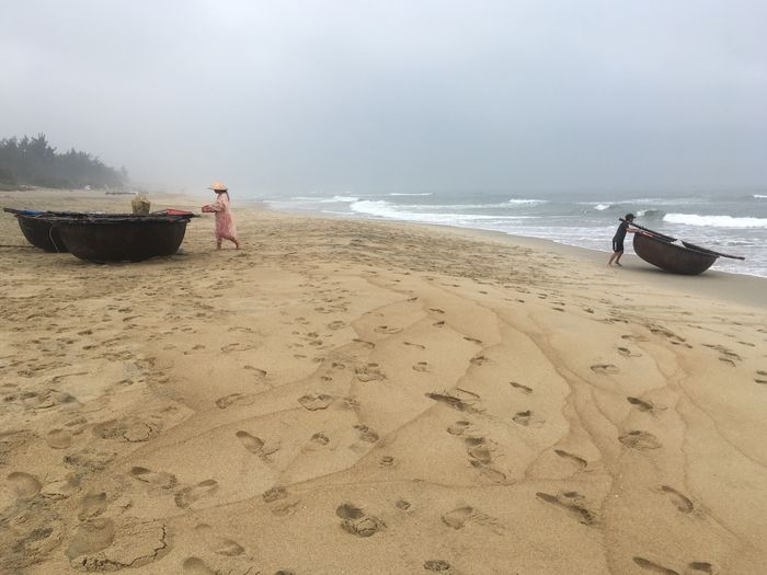 People Working On Shore At Beach