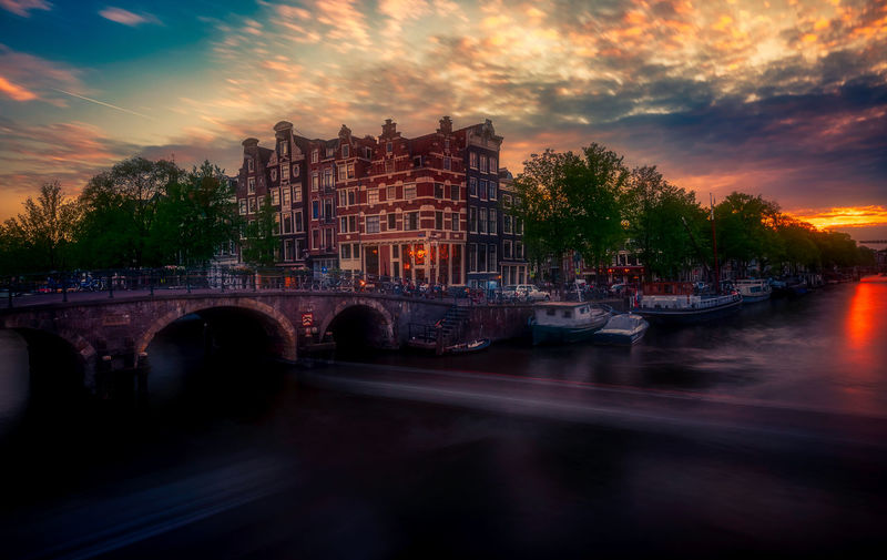 Amsterdam Remo SCarfo Dutch Holland Tulips Sunset EyeEm Best Shots EyeEmNewHere Water Built Structure Architecture Sky Building Exterior Cloud - Sky Transportation Nautical Vessel River City Mode Of Transportation Bridge Nature Bridge - Man Made Structure Connection No People Dusk Building Outdoors Arch Bridge