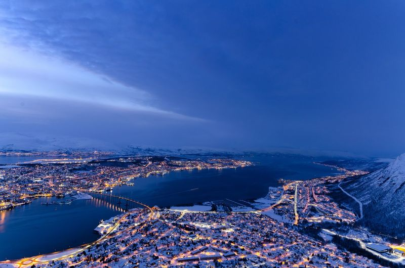 The view of Arctic town Tromsø surrounded by chilly fjords and snow covered rocky peaks! Though this place is inside the cold Arctic circle, the city lights radiate its lively atmosphere. Water City Sky Sea Aerial View High Angle View Outdoors Norway Tromsø Blue Hour Blue Scandinavia Island Arctic Circle Stay Out