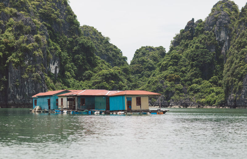Houses in lake against mountains