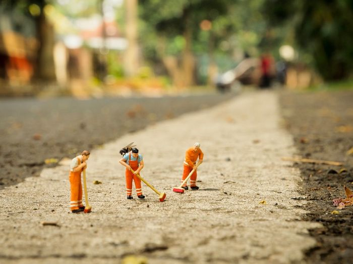 Close-up of toys on the road