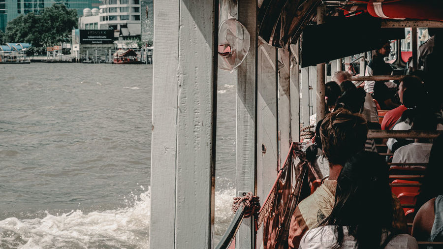People on ferry sailing in sea