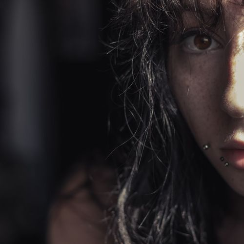says she talks to angels // Freckles Women ThatsMe Half Face Brown Eyes Piercing One Person Ways Of Seeing Black Background Looking At Camera Girls Human Eye Headshot Close-up