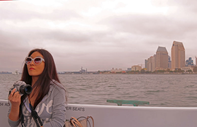My wife and I on the way to Coronado Island. She's just too cool. Architecture Boat Boat Ride Buildings Canonphotography City Life Cloudy Day Date Date With My Wife Lifestyles Outdoors San Diego Ca Shades Sky And Clouds Team Awesome Team Awesome's Adventure Water Shades