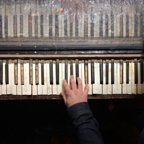 Close-Up Person Hand Playing Piano