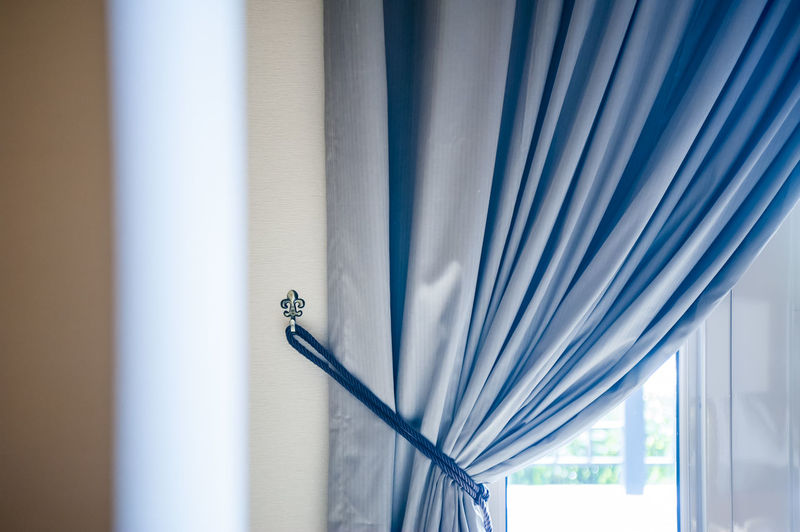 Curtain by window at home