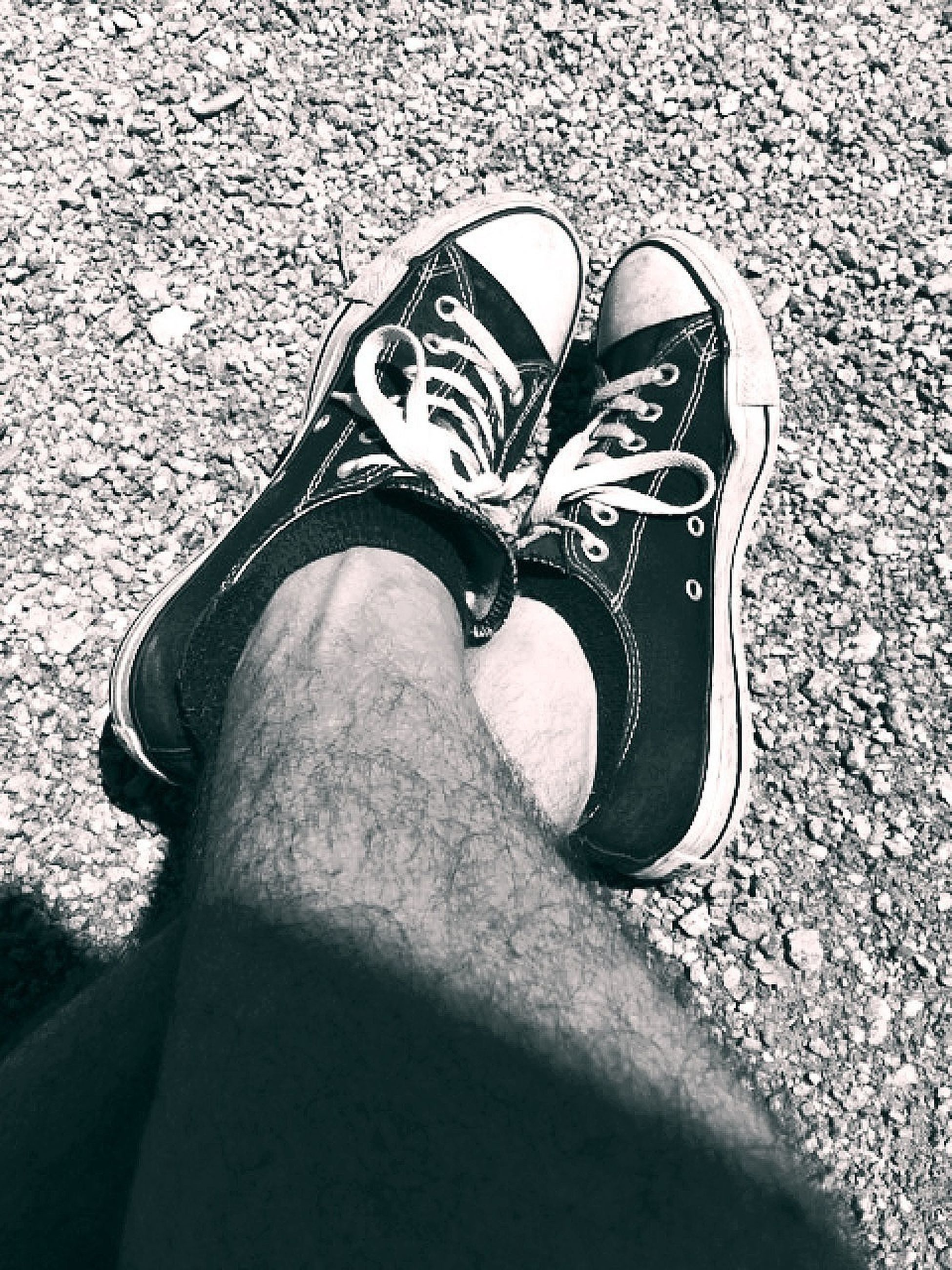 shoe, low section, person, footwear, personal perspective, high angle view, canvas shoe, pair, jeans, human foot, close-up, shoelace, street, standing, ground, day, part of