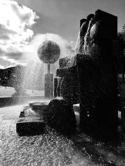 Motion Sky Sunbeam Water Cloud - Sky Fountain Spraying Stone Material Outdoors Splashing Downtown Square History Sun No People Creativity
