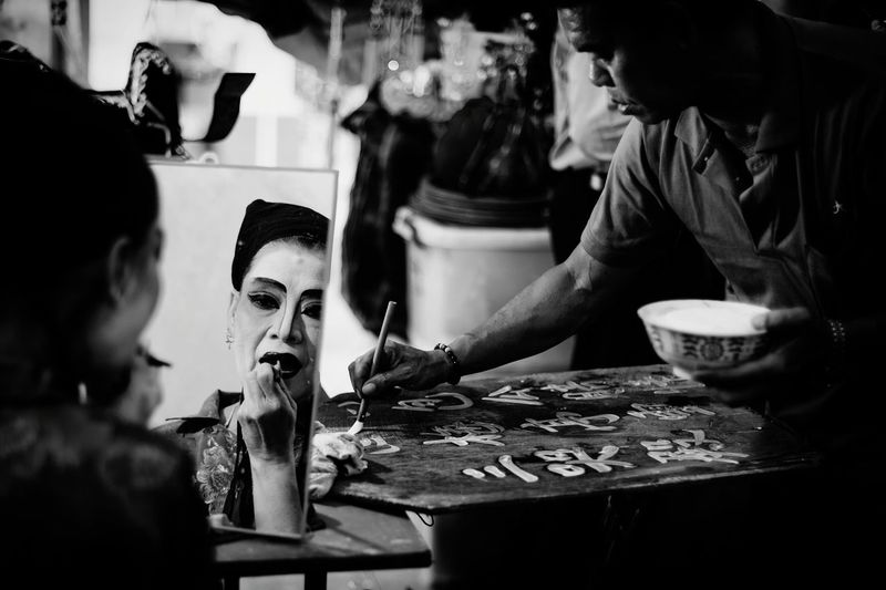 Shades Of Grey Chinese Opera Troupe Painted Face Lady Makeup Artist Black And White Traditional Culture Portrait Of A Teochew Opera Singer Asia Art Form Man Handwriting Chinese Characters Live To Learn B&w Street Photography An Eye For Travel