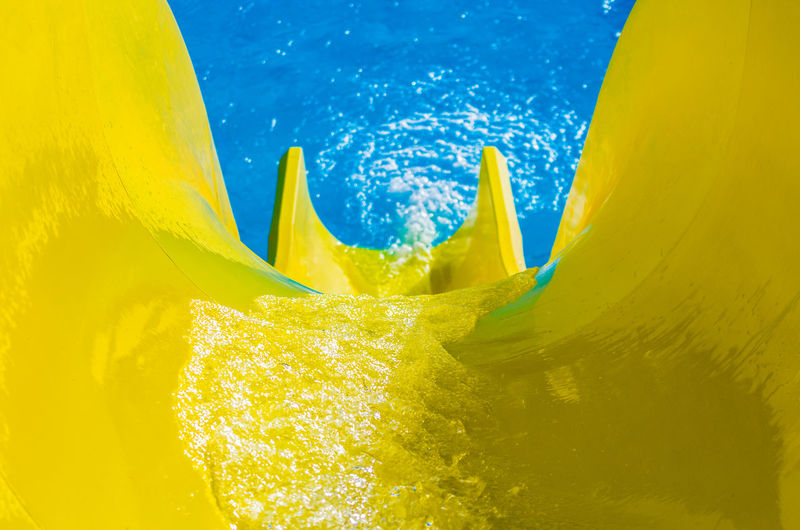 High angle view of yellow slide at water park