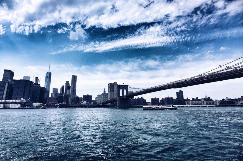 Brooklyn bridge over east river with manhattan skyline