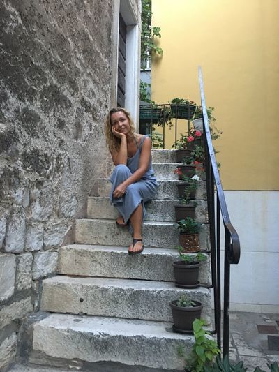 Steps Staircase Steps And Staircases Full Length One Person Architecture Built Structure Young Women Young Adult Long Hair Leisure Activity Stairs Real People Lifestyles Sitting Leaning Beautiful Woman Day Women Outdoors