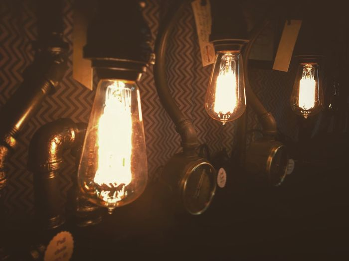 Glowing Illuminated Light Bulb Close-up Indoors  Filament Antique Vintage Old-fashioned Nealnoahphotography Getty Images Object No People Stockphoto Moody Mood