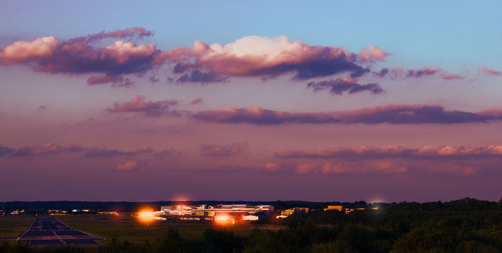 Airport Against Cloudy Sky At Sunset