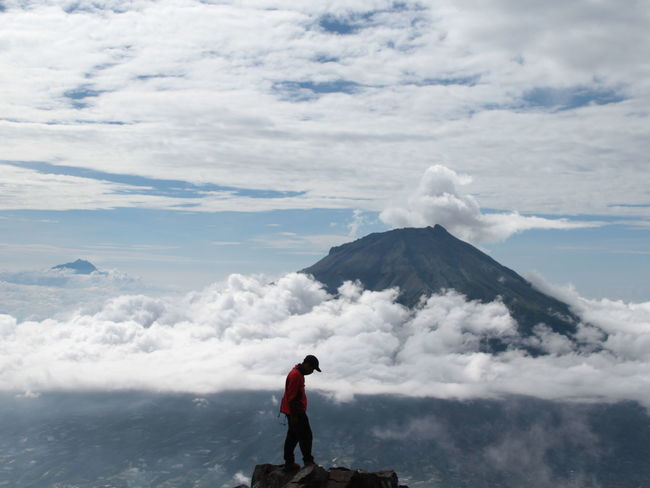 I want to fly over the mountain Cloud - Sky Sky Real People Mountain Beauty In Nature Scenics - Nature One Person Day Nature Standing Leisure Activity Lifestyles Men Non-urban Scene Volcano Tranquility Tranquil Scene Rear View Vacations Outdoors Looking At View Power In Nature Sindoro INDONESIA Jawatengah