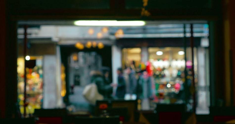 Defocused image of illuminated restaurant at night