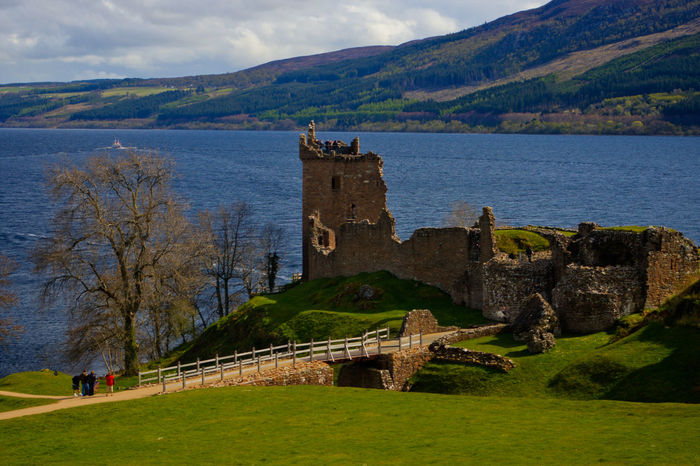 Scotland UrquhartCastle Ancient Architecture Beauty In Nature Building Exterior Built Structure Castle Day Fort Grass History Loch Ness Mountain Nature No People Outdoors Scenics Sky The Past Travel Travel Destinations