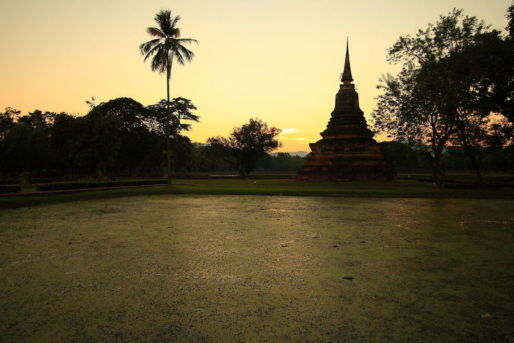 Architecture Cultures Gold Gold Colored No People Outdoors Pagoda Place Of Worship Religion Sky Spirituality Sukhothai Sukhothai Historical Park Sukhothai, Thailand Sukhothaiheritage Sukhothaihistoricalpark Sunset Temple Thai Thailand Tourism Travel Travel Destinations Tree Vacations