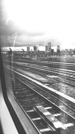 Leaving a dull day in the city Traveling Train Cityoflondon City London Clouds Cityscape Blurred Visions Shades Of Grey