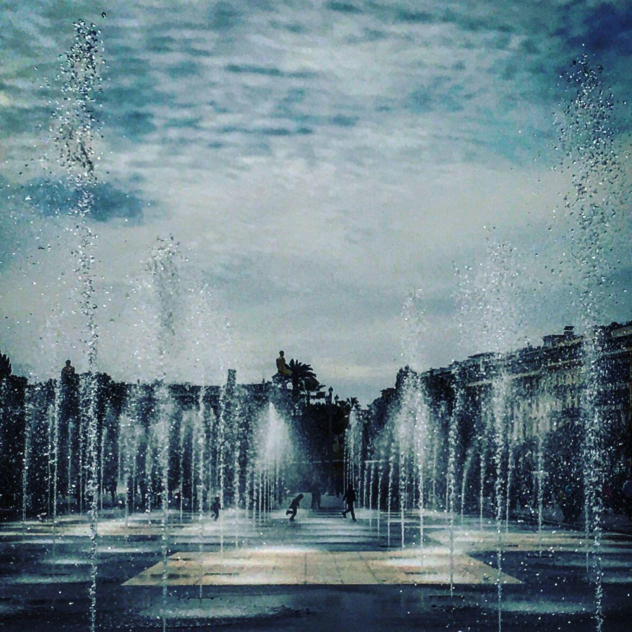 water, spraying, fountain, motion, splashing, wet, drop, sprinkler, long exposure, outdoors, day, refreshment, tree, sky, no people, car wash, nature, irrigation equipment