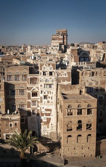 view of traditional buildings skyline in downtown Sanaa city old town in Yemen Architecture Building Exterior Built Structure Building City Residential District No People Day Sanaa Sana'a Yemen Yemeni Yemeni Tradition Arabian Architecture Traditional Architecture Ancient City Old Town Skyline Heritage