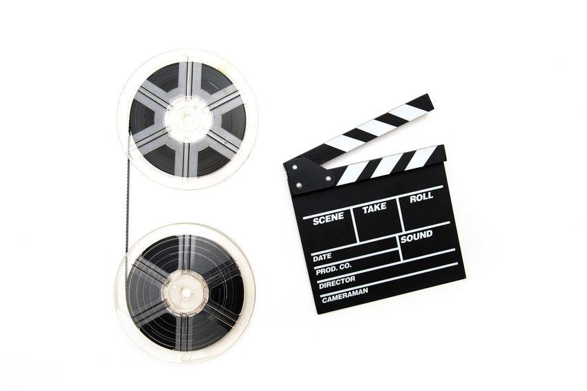 Movie clapperboard and super 8 film reels Celluloid Cinema Clapper Clapperboard Film MOVIE No People Old Reel Reels Roll Studio Shot Super 8 Technology Vintage White Background