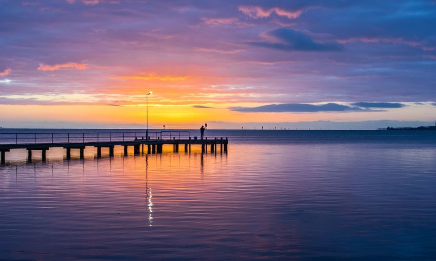 Water Sky Sunset Beauty In Nature Scenics - Nature Cloud - Sky Sea Tranquility Tranquil Scene Reflection Waterfront Horizon Over Water Orange Color Nature Horizon Idyllic Pier No People Outdoors Wooden Post Sunrise And Clouds Sunrise Sunrise_sunsets_aroundworld