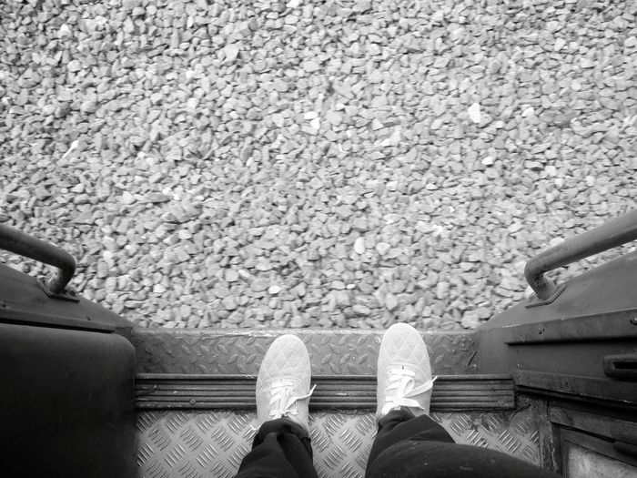 Stationed feet on a running train cruising through God's own Country Kerala. #feer #traveller #journey #Train #indianrailway #southindia #bnw #looking Down #Tracks