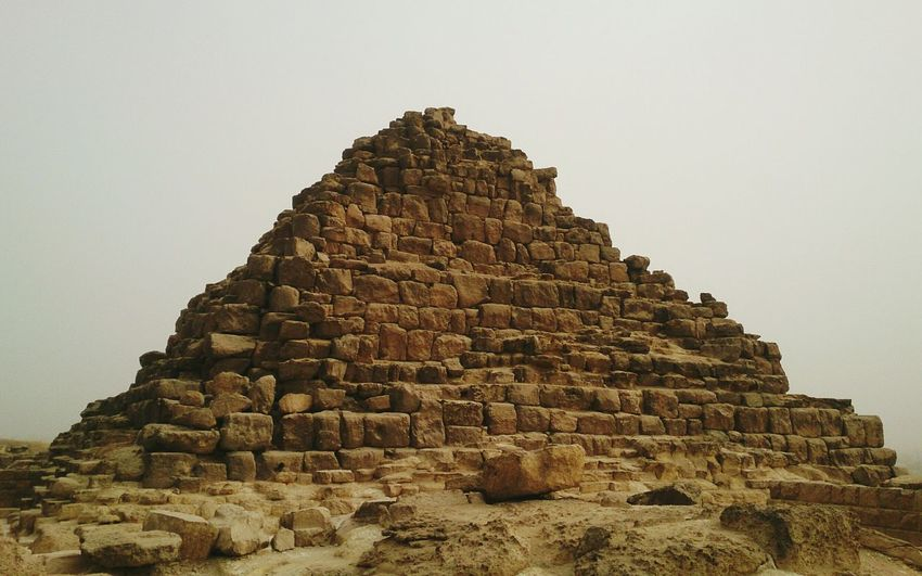 Low angle view of pyramid against clear sky