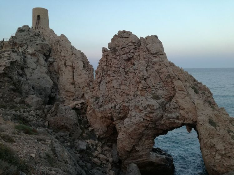 Horizon Over Water Day No People Beauty In Nature Tranquil Scene Rock - Object Rock Formation Sea Nature Rock Scenics Tranquility Cliff Physical Geography Clear Sky Sky Outdoors