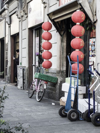 Architecture Building Exterior Transportation Built Structure Building City Mode Of Transportation Day Street Land Vehicle Lantern Outdoors No People Lighting Equipment Chinese Lantern Bicycle Road Travel Footpath Alley Wheel