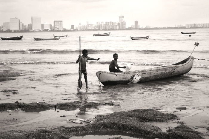 Beach Boat Cityscapes Depth Of Field Fishing Fun Kids Mode Of Transport Rythm Sand Sea Seashore Seaside Sepia Sky Skyline Transportation Water Working Working Hard
