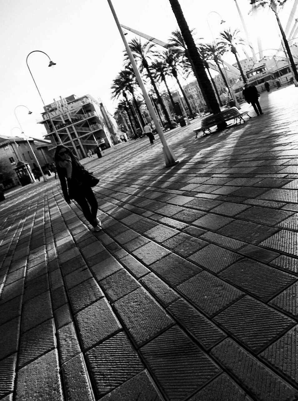 walking, full length, one person, city, outdoors, real people, architecture, day, sky, people