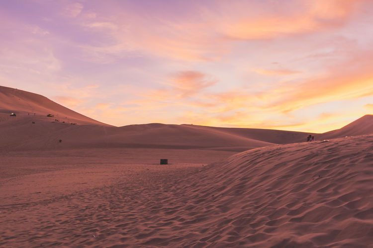 Arid Climate Beauty In Nature Cloud Cloud - Sky Desert Golden Hour Huacachina Huacachina, Peru Idyllic Landscape Mountain Mountain Range Nature Non-urban Scene Orange Color Outdoors Remote Scenics Sky Sunset Sunset_collection Tourism Tranquil Scene Tranquility Travel Destinations