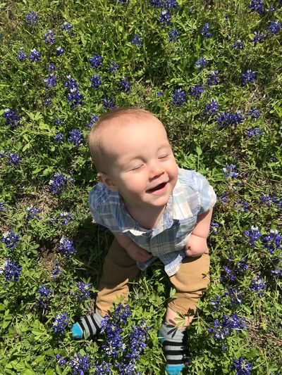 Loving the spring weather Grandbabies Looking To Heaven Spring In Texas Spring In Texas Texas State Flower One Person Child Plant Real People Leisure Activity Childhood Lifestyles