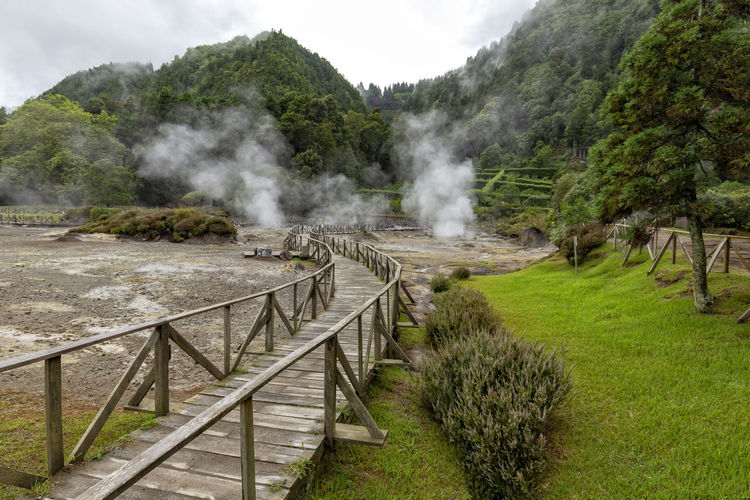 Thermal vents and a path for visitors to check them out at Fumarolas da Lagoa das Furnas. Furnas Azores Açores Tourism Visit Travel Destination Sao Miguel Nature Outdoors Poca Da Dona Beija Hot Spring Thermal Volcanic  Pool Bath Europe Steam Island Geyser Vent Path Portugal Portuguese