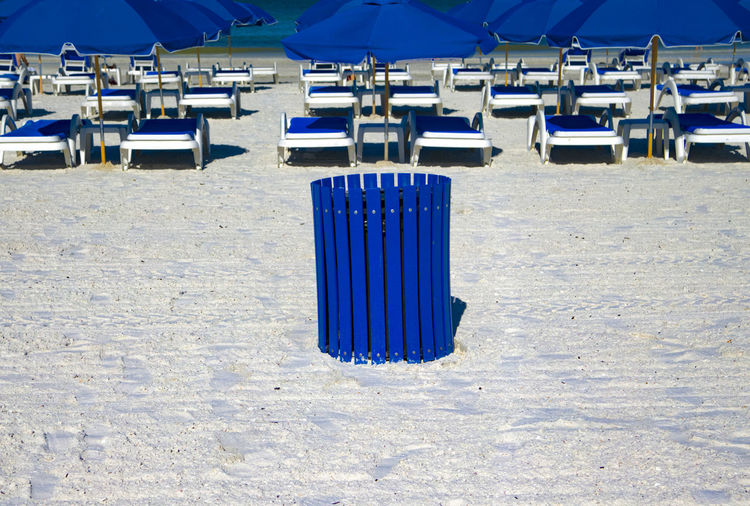 View of blue chairs on beach