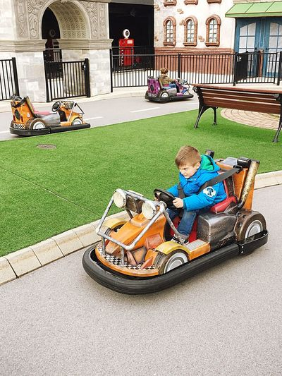 Power to win Childhood Child Full Length Grass Boys Transportation Inner Power Day One Person Real People Mode Of Transportation Land Vehicle Outdoors