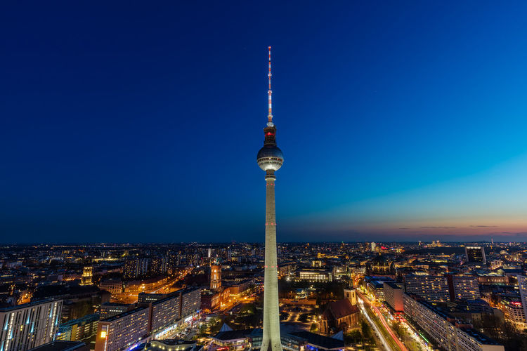 Berlin tv tower at sunset against blue sky