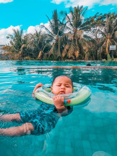 Full length of boy swimming in pool