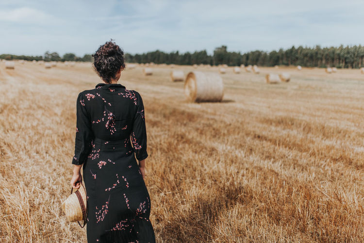 Adult Alentejo Alentejo,Portugal Beauty In Nature Black Dress Day Dress Field Hay Bale Landscape Lifestyles Nature One Person Outdoors People Real People Rear View Rear View Sky Standing Women Your Ticket To Europe
