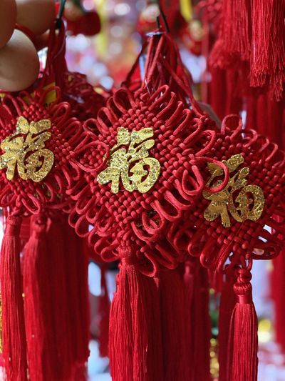Close-up of red decoration hanging against blurred background