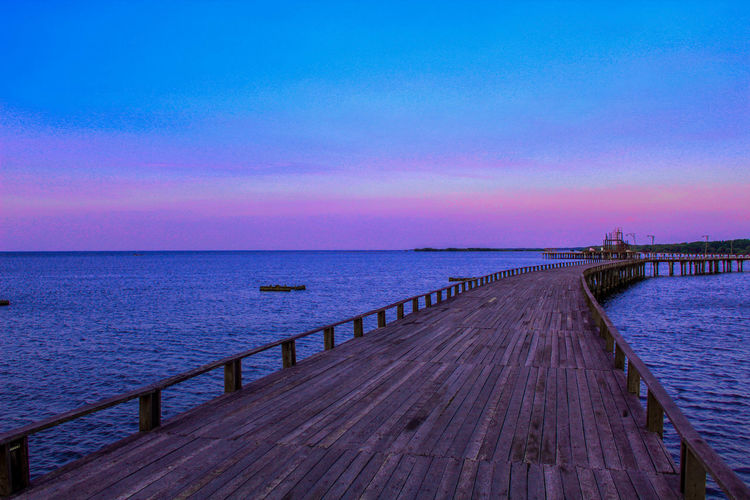 Way on Water Water Sea Beach Sunset Blue Clear Sky Purple Sky Horizon Over Water Romantic Sky Harbor Low Tide Marina Mooring Post Footbridge The Way Forward Calm Diminishing Perspective Port A New Beginning