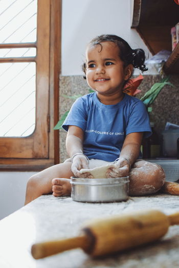 Little baker 👼 EyeEm Selects InMakin! Niece  Indoors  Baby Childhood Domestic Life Day Portrait Sitting Child People Food Dough Rolling Pin Kneading Smiling Preparation  EyeEm Ready   Love Yourself Press For Progress Inner Power This Is Family