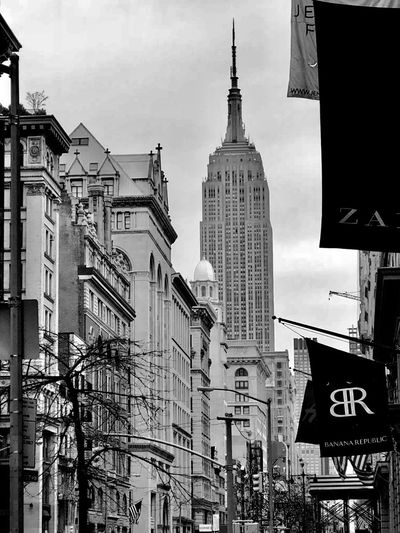 Walking in New York 5th Avenue, NYC Empire State Building Building Exterior Architecture Built Structure Low Angle View Outdoors No People Sky