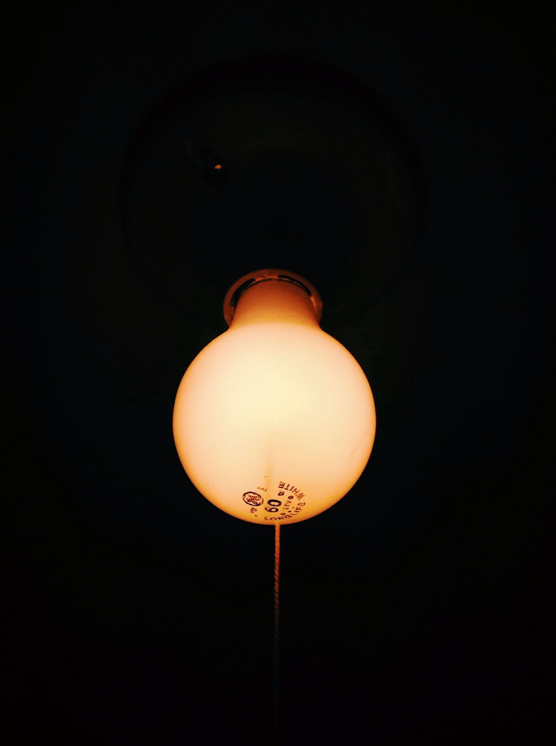 lighting equipment, illuminated, electricity, low angle view, copy space, electric light, electric lamp, light bulb, street light, night, hanging, lamp, indoors, sphere, dark, technology, ceiling, glowing, studio shot, no people
