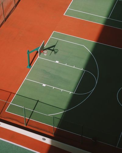 Empty basketball court with shadow Competition Basketball Hoop Orange Park Afternoon Shadow America Basketball Basketball Court Sport High Angle View Competition Athlete Real People Court Running Track Day Sports Track Stadium Outdoors Sportsman Playing Field