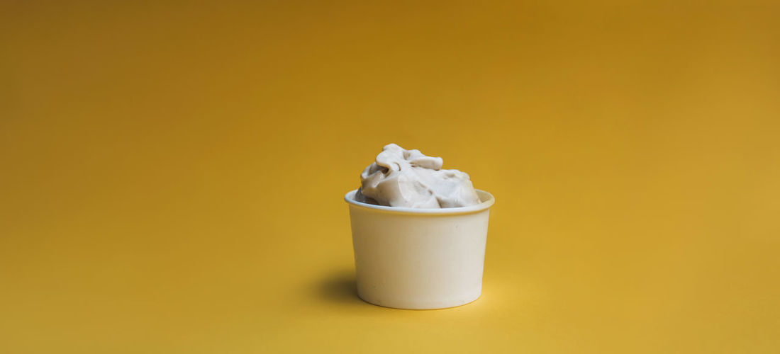 Close-up of drink against yellow background