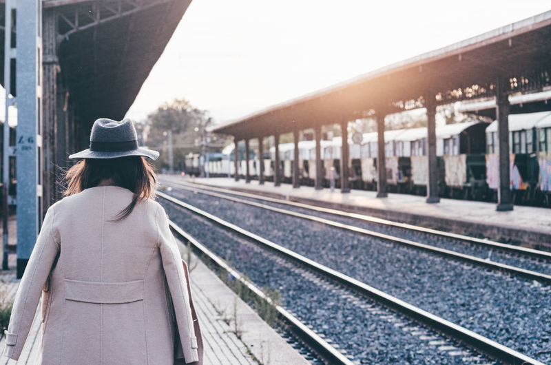 Rear view of woman on railroad station platform